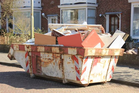 Skip Hire Outside A House